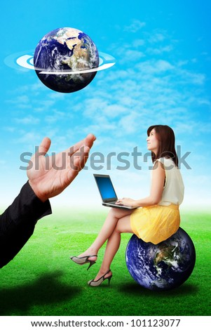 Business woman look at the tiny earth from god hand : Elements of this image furnished by NASA - stock photo