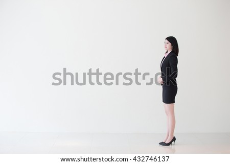 business woman look something with white wall background, great for your design or text, asian - stock photo