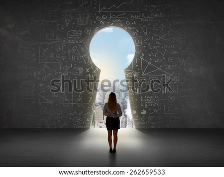 Business woman looking at keyhole with bright cityscape concept background - stock photo