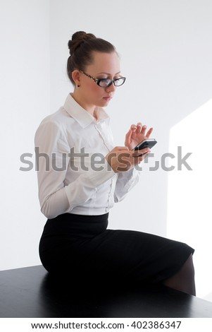 Business woman looking at phone - stock photo