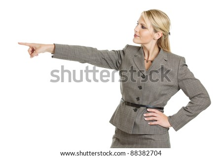 Business woman looking at pointing to the left isolated on a white background - stock photo