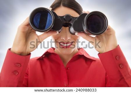 business woman looking through binoculars - stock photo