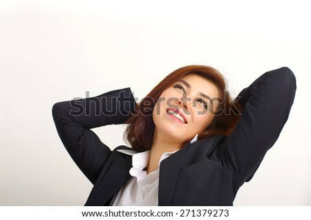 business woman looking up and relax - stock photo