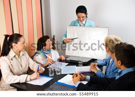 Business woman making a presentation and indicate with pencil on blank board at meeting,copy space for text message - stock photo