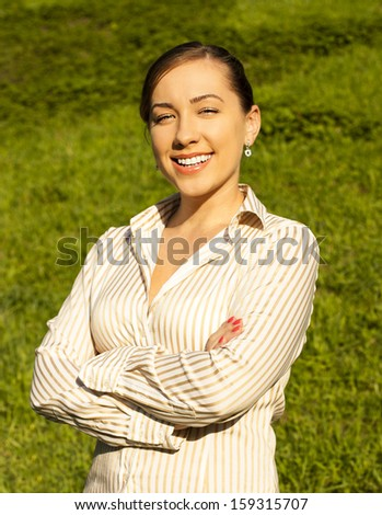 Business woman on the street crossed her arms - stock photo