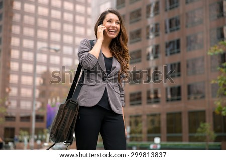 Business woman on way to work young executive successful happy smile walking city - stock photo