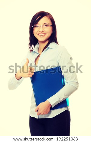 Business woman or student portrait smiling - stock photo