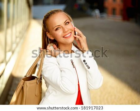 Business woman outside on a break - stock photo