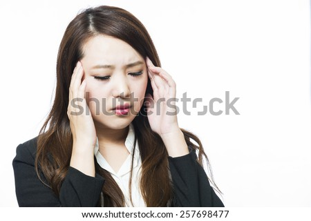 Business woman physically uncomfortable headache - stock photo