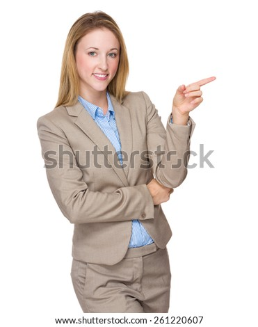 Business woman pointing at copyspace - stock photo
