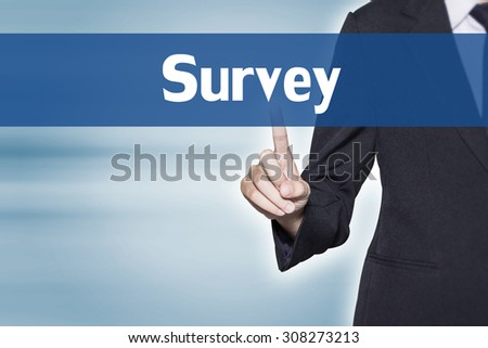 Business woman pointing at Survey word for business background concept - stock photo