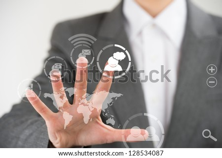 Business woman pointing her fingers on virtual web interface icons - stock photo