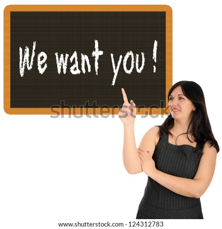 Business Woman pointing up to a sign with the words We want you / Business Woman - stock photo
