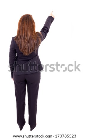 Business woman points finger at something, isolated over white background - stock photo