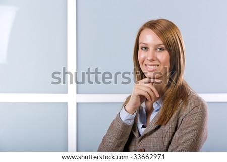Business woman portrait in a modern office - stock photo