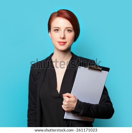 Business woman portrait on blue background - stock photo
