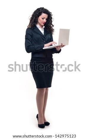 Business woman portrait using laptop. Full body studio shot. - stock photo