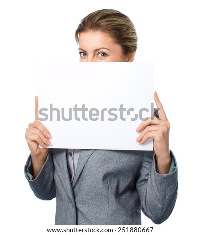 Business woman portrait with blank white banner, isolated over white - stock photo