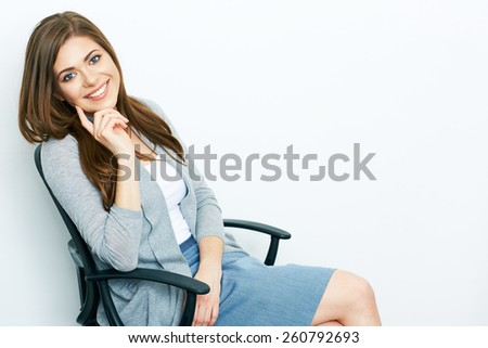 Business woman positive thinking. smiling model sitting in chair. Isolated white background studio portrait. - stock photo