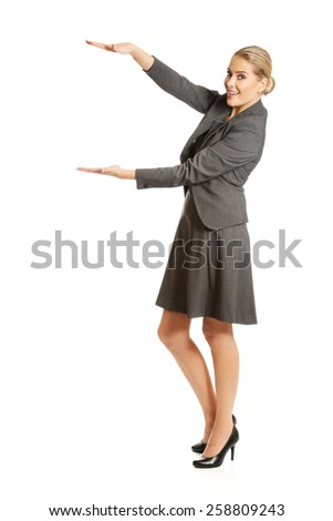 Business woman presenting a copyspace.  - stock photo