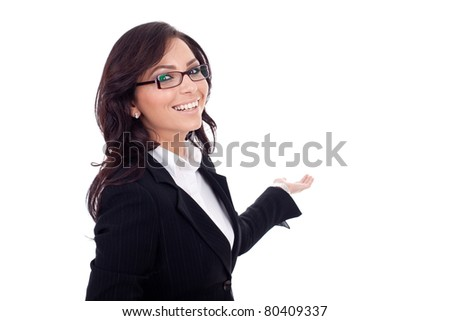 Business woman presents something in her back. Isolated on white background - stock photo
