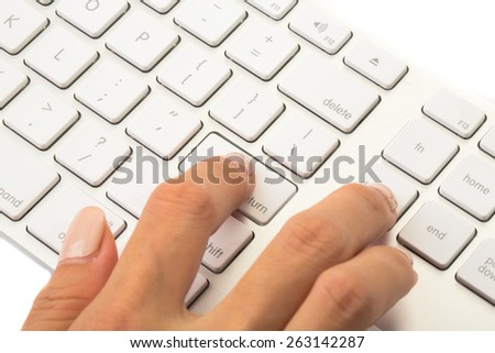 Business woman press enter on white keyboard to start or end commercial process. - stock photo