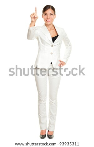 Business woman pressing invisible button with index finger standing in full length isolated on white background. Beautiful young happy smiling multi-cultural Asian / Caucasian businesswoman. - stock photo