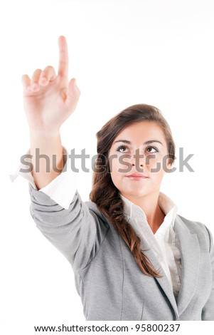 Business woman pressing key - stock photo