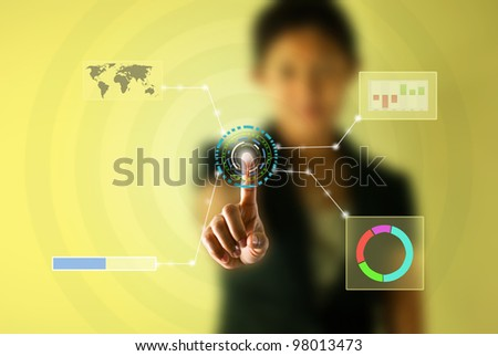 Business woman pressing virtual button - stock photo