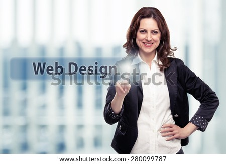 Business woman pressing Web Design button at her office. Toned photo - stock photo