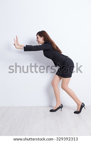business woman push something with white wall background, great for your design or text, asian - stock photo