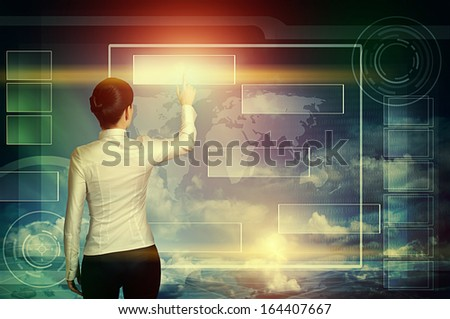 business woman push virtual icon in multicolored web interface over blue cloudy sky - stock photo