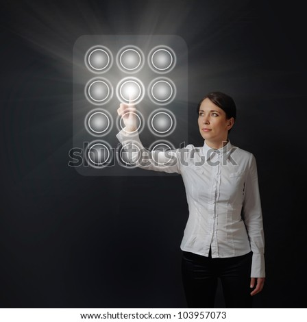 business woman pushing button on virtual dial panel on black background - stock photo