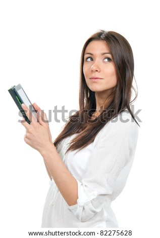 Business woman reading ebook device and looking up isolated on a white background - stock photo