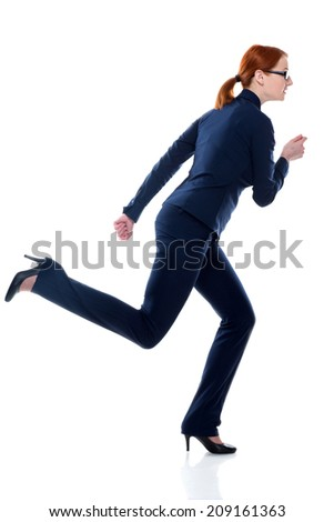Business woman running in suit in full body isolated on white background. Business concept image - stock photo