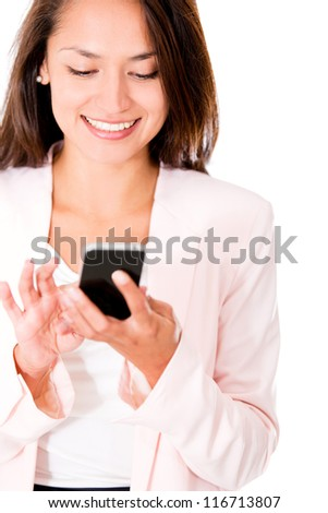 Business woman sending a text message from her phone - stock photo