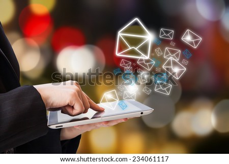 Business woman sending email  - stock photo