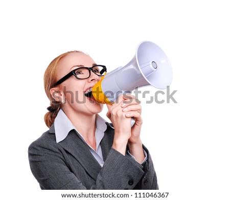 Business woman shouting  loud into a megaphone - stock photo
