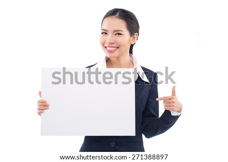 Business Woman showing blank paper sign whiteboard. Fresh, happy and joyful multiracial girl in her twenties showing copy space for your message. Isolated on white background - stock photo