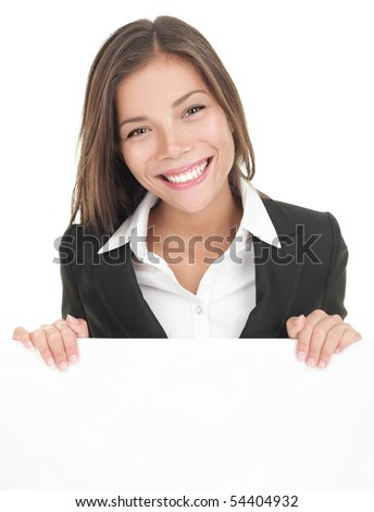 Business woman showing blank sign board. Asian busineeswoman in suit presenting billboard isolated on white background. Young Asian / Caucasian female model. - stock photo