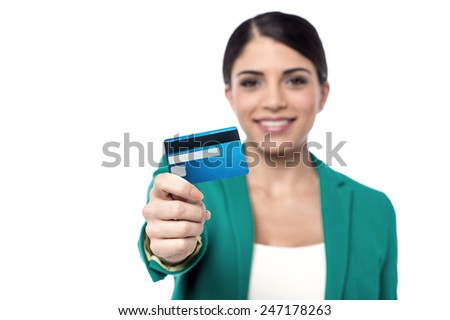 Business woman showing cash card, focus on card - stock photo