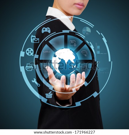 Business woman showing globe and icon application on virtual screen. Concept of  online business technology. - stock photo
