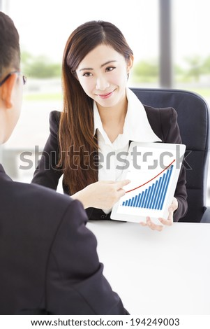 Business woman showing good financial situation - stock photo