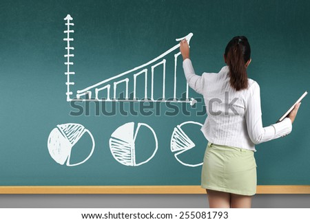 Business woman showing Graph on the board  - stock photo