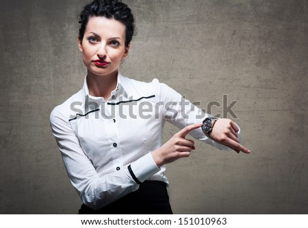Business woman showing the time on her wrist watch. - stock photo