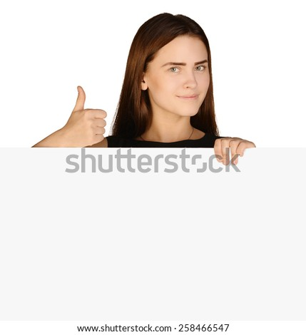 Business woman showing thumb up and holding a blank banner - stock photo