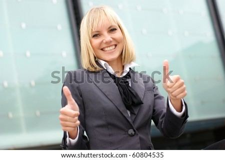 business woman shows the signs of success - stock photo