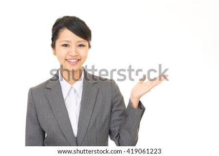 Business woman shows the way - stock photo