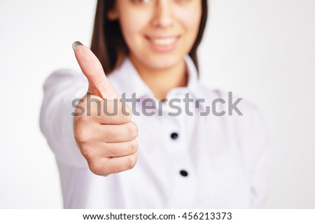 Business woman shows thumb up. - stock photo
