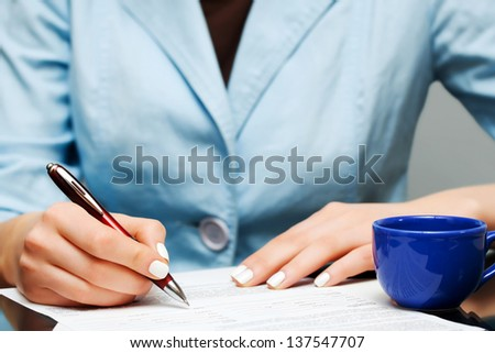 Business woman signing contract - stock photo